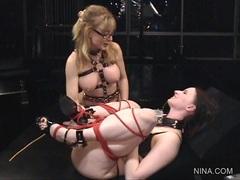 Horny Claire Adams gets tied up by kinky Nina Hartley