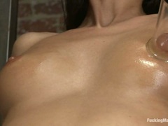 Nikki Daniels pumps the hell out of her red nipples