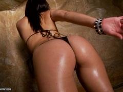 Tart Ann Marie oils up her bouncy butt cheeks