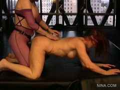 Blistering Nina Hartley fucks this babe with a toy