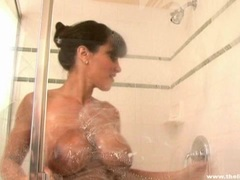 Hot wet shower action with stunning MILF Lisa Ann