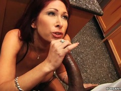 Tempting Tiffany Mynx wraps her lips round a huge dick