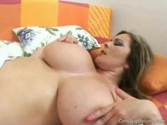 Constance Devil plays with her huge mega melons
