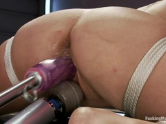 Naughty Katie Kox is slammed up her snatch by a machine