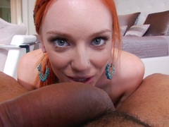 Redhead Dani Jensen stuffs her mouth with hard cock