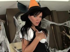 Brunette in fishnets and stilettos loves Halloween