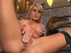 Luscious Randy Moore loves teasing her moist pussy