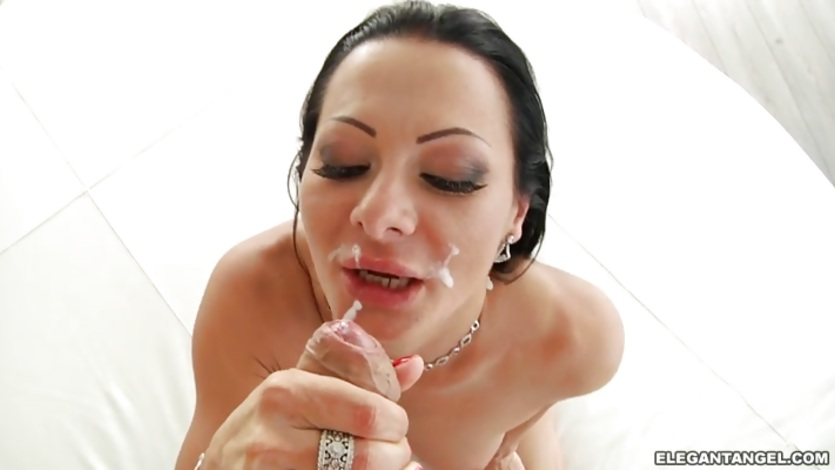 Sandra Romain gets her face drizzled with warm jizz