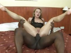 MILF gets a butt ramming from a thick black shaft