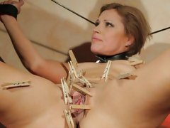 Szilvia Lauren endures some painful pussy play