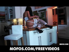 April Blue with a perfect ass is fucked in the kitchen