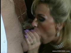 Alexia Knight slobbers over this hard throbbing cock