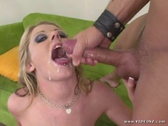 Sophie Dee gets her face sprayed with thick dick juice