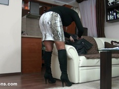 MILF shows her nylons and boots