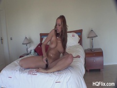 Girl pumps her neatly trimmed pussy