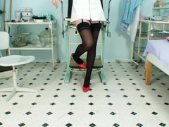Sultry nurse gives herself an exam