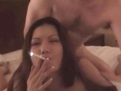 Asian smokes as she sucks and fucks