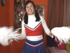 Sweet Asian cheerleader's getting a facial