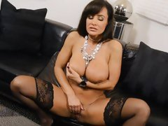 Lisa Ann loves tormenting her juicy moist pussy