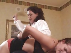 Mature brunette spanking her naughty roommate