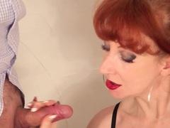 Redheaded MILF tantalises a lucky dick