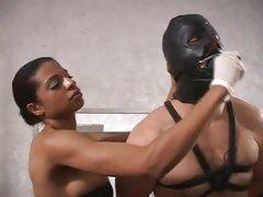 Ebony dominatrix plugs her slave