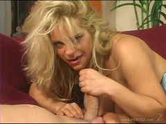 Tantalizing babe gets showered with thick cum