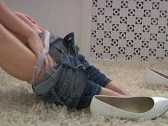 Blonde pulls down her jeans and plays
