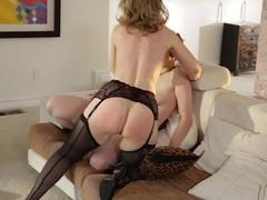 MILF Nina Hartley rides a tomboys strap on cock