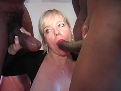 MILF surrounded by throbbing black cock