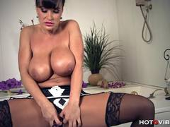 Lisa Ann shows off her round tits