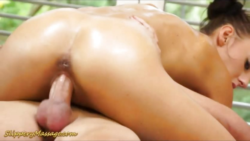 Oiled Ella Storm gets her warm pussy hammered