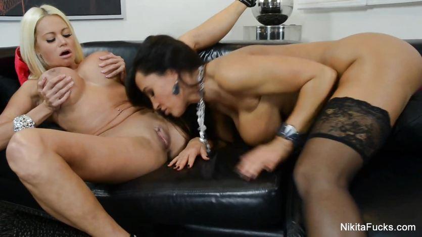 Lisa Ann nibbles on Nikita Von James moist clit