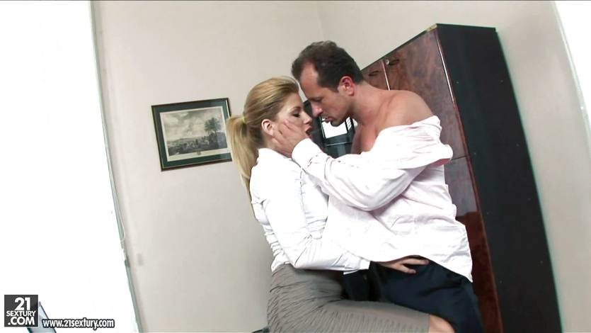 Brooklyn Lee stands up against the desk and takes a cock from behind