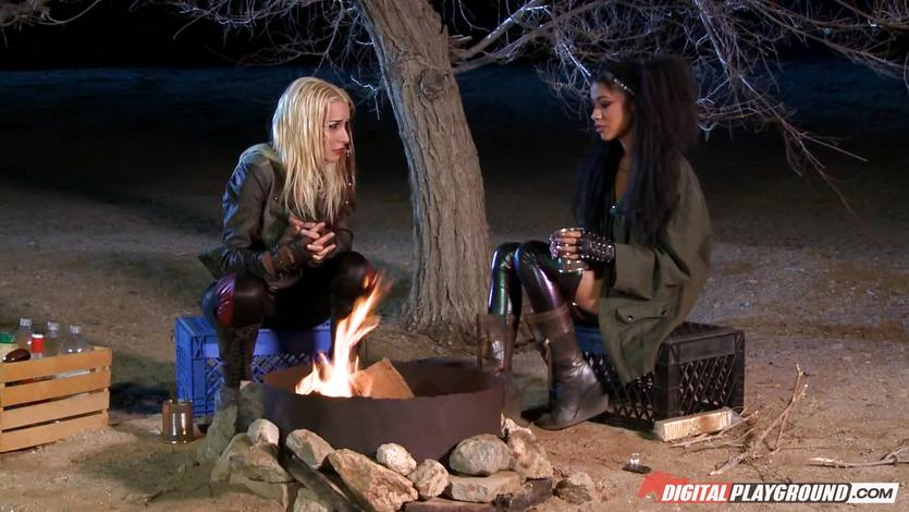 Stevie Shae and Veronica Rodriguez warm by the bonfire