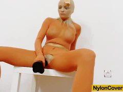 Nylon clad Nicky Angel dildo fucks her hot pussy