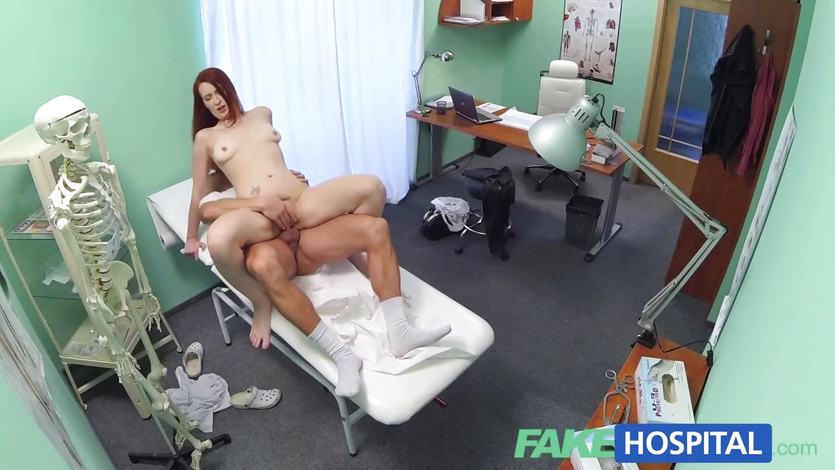 Sexy redhead surprises doctor