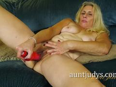 Blonde Cristine Ruby dildo fucks her moist slot