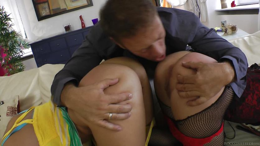 Rocco Siffredi pounds his huge cock into two horny girls