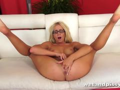 Blonde Kiara Lord rubs her warm pussy