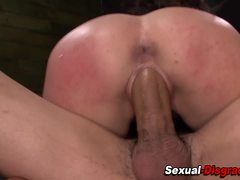 Bound slave gags on dick