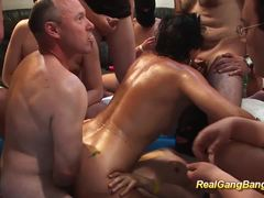 Oiled moms first real gangbang action