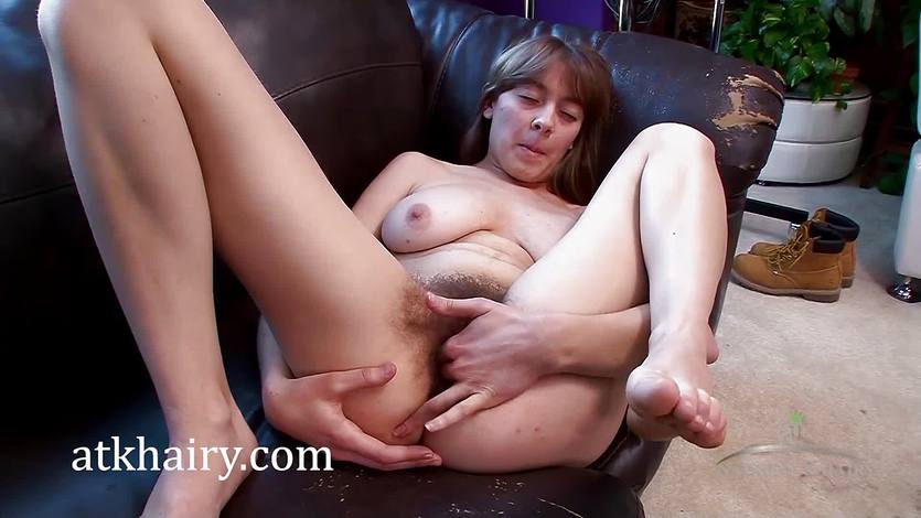 Brunette Clara Brown plays with her hairy pussy