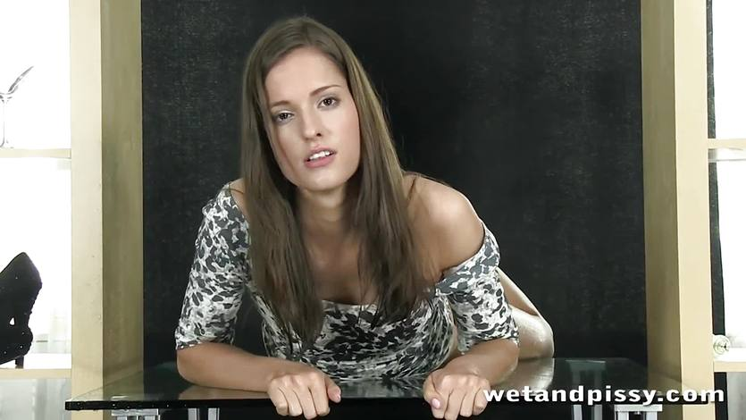 Gorgeous brunette loves to pee