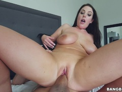 Brunette hottie Angela White wanking a cock with her big tits
