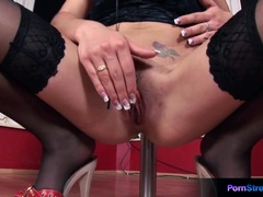 Pole dancing babe toys her pussy with a dildo