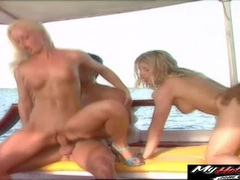 Lea De Mae and Silvia Saint sailing on the ocean while blowing on franco and Nacho