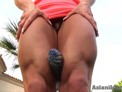 Blonde strong women dildos as she flexes her muscles