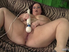 Hot big boobed plumper uses a red vibrator on her hot pussy