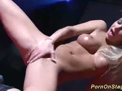 Busty blonde hot orgasm on public stage